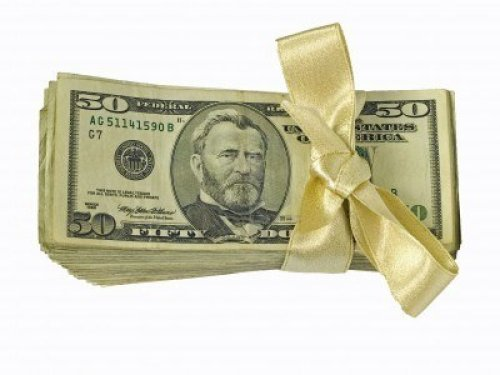 4268629-fifty-dollar-bills-tied-with-a-gold-ribbon