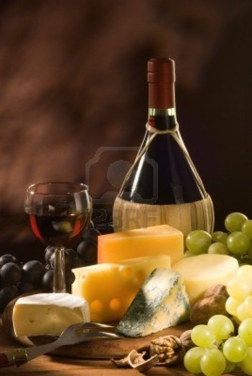 5817464-glass-and-bottle-of-red-italian-wine-with-various-types-of-cheese-and-garnishes
