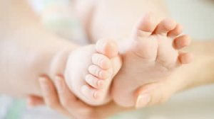 stock-footage-baby-foots-on-the-light-background
