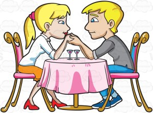 A blonde couple in love, sitting on a pink chair and separated by a round table with pink cloth, looking at each other adoringly, as they both hold on to the hands of each other