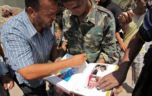 caucus-libya-condoleezza-qaddafi-blog480