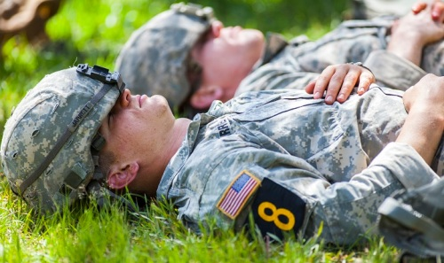 U.S. Army Rangers, rest for a moment in between events during the Best Ranger Competition 2016, at Fort Benning, Ga., April 16, 2016. The 33rd annual David E. Grange Jr. Best Ranger Competition 2016 is a three-day event consisting of challenges that test competitor's physical, mental, and technical capabilities. The Rangers compete for nearly sixty hours with little or no sleep, and must rest intermittently for minutes at a time while waiting to begin their next event.  (U.S. Army photo by Staff Sgt. Justin P. Morelli / Released)